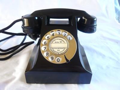 A BRASS DIAL BAKELITE TELEPHONE