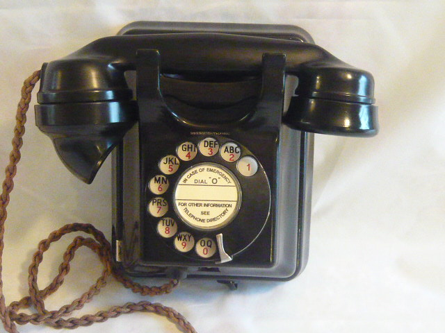 A VINTAGE ART DECO BAKELITE WALL TELEPHONE