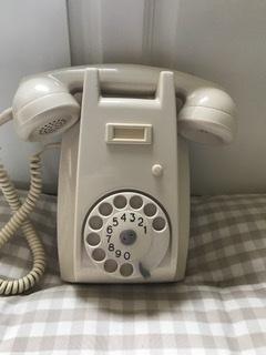 A VINTAGE IVORY ART DECO BAKELITE WALL TELEPHONE