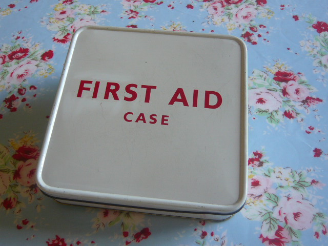 z/sold  A Vintage First Aid box with full contents